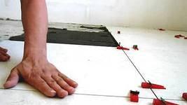 Выравнивания плитки своими руками